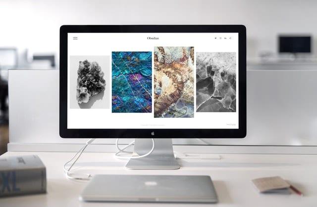 WordPress web design on imac near macbook laptop