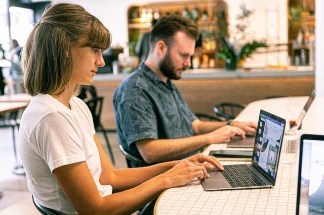 photo of web designers using laptop