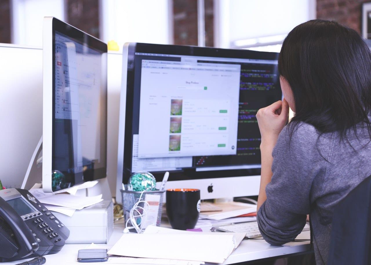 web developer doing website maintenance on computer